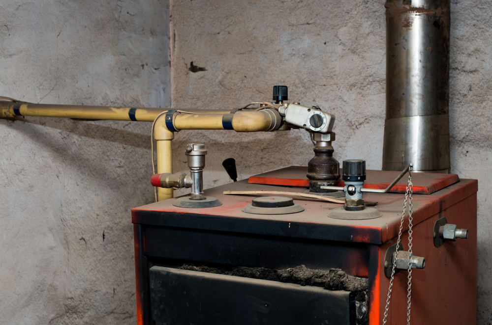 Old home heating system in need of furnace replacement in Concord, MA