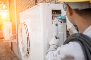 Tech installing a new AC system in Belmont, MA paid for with a HEAT loan