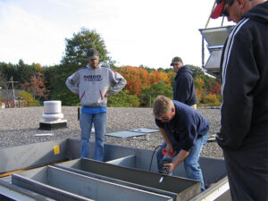 Muirfield Mechanical team working on an HVAC installation in Concord, MA